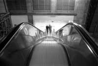 Escalator - 'Portrait of a Train Station in Holland', photography by www.choughmountain.eu