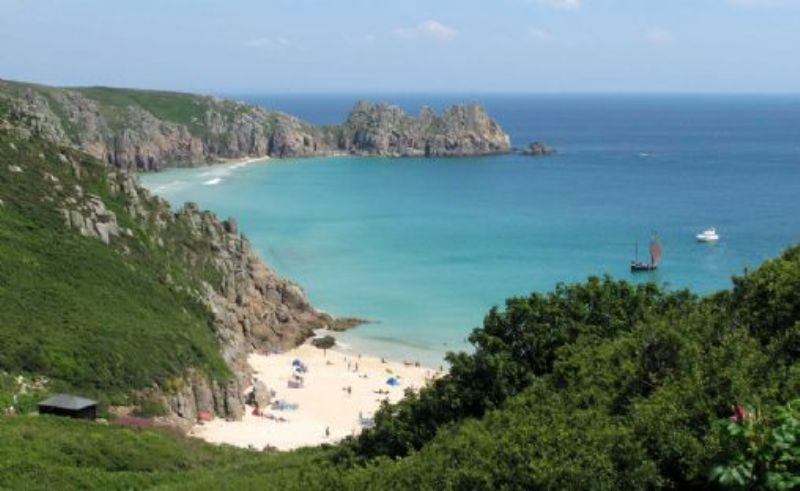Treryn Dinas with Porthcurno Beach in the foreground
